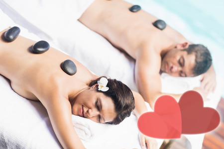 couple getting hot stone massage Stock Photo