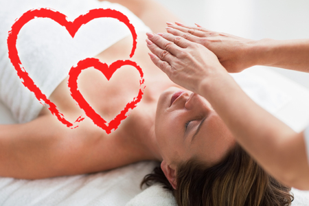 thearapist performing reiki on woman Stock Photo