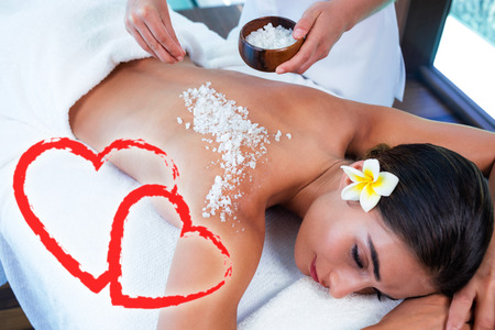 woman enjoying salt scrub massage