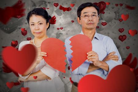 long hair boy: Couple holding broken heart against love heart pattern
