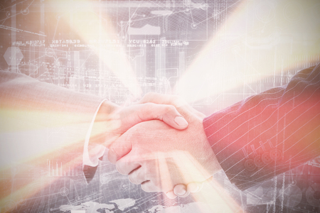 Business people shaking hands against hologram background Stock Photo - 71093577