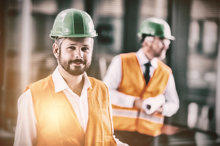 Portrait of architect in hard hat standing in office corridor Stock Photo