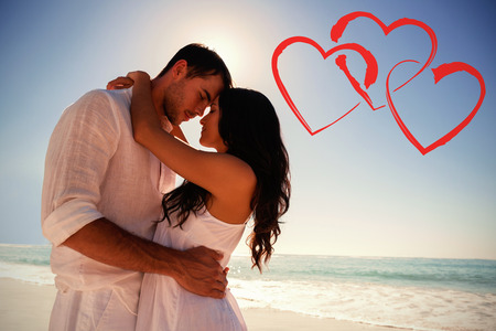 Romantic couple embracing  against print