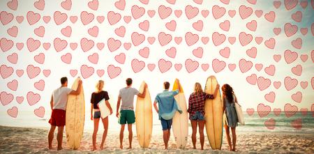 friends holding surfboard at beach