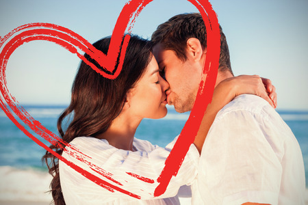 Couple embracing and kissing each other on the beach against print Stock Photo