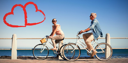 Happy casual couple going for a bike ride on the pier against print