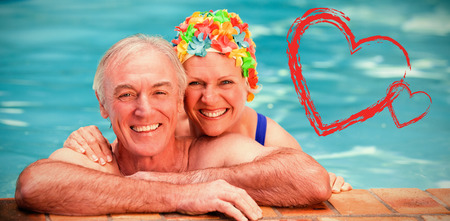 Happy mature couple in the swimming pool  against print photo