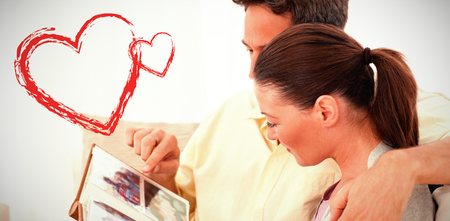 side view of lovely couple looking at pictures Stock Photo