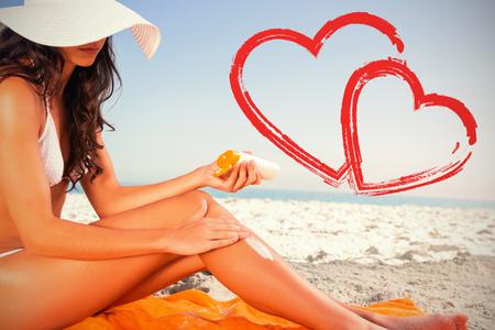 sexy young woman applying sun cream