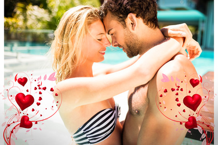 Valentines heart design against happy couple embracing in pool 3d photo