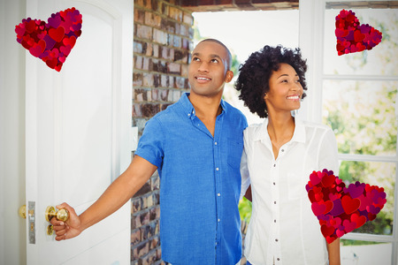 Heart against happy couple about to open the door 3d Stock Photo