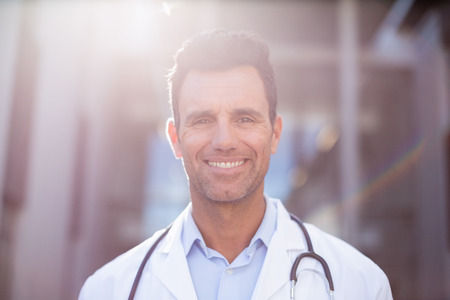 iv: Portrait of smiling doctor in hospital