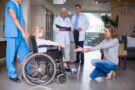 Happy mother meeting her disable daughter in hospital corridor