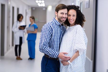 maternal: Portrait of happy couple standing in corridor of hospital Stock Photo