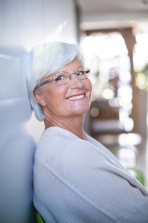 ageing process: Portrait of senior woman sitting on sofa in clinic Stock Photo