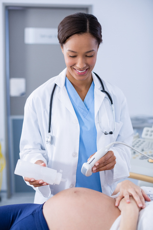 sonography: Doctor doing ultrasound scan for pregnant woman in hospital Stock Photo