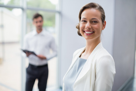 company premises: Portrait of a cheerful businesswoman at conference centre
