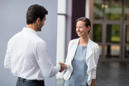 conference centre: Business executives shaking hands with each other at conference centre