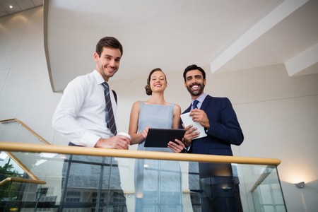conference centre: Portrait of business executives holding digital tablet at conference centre