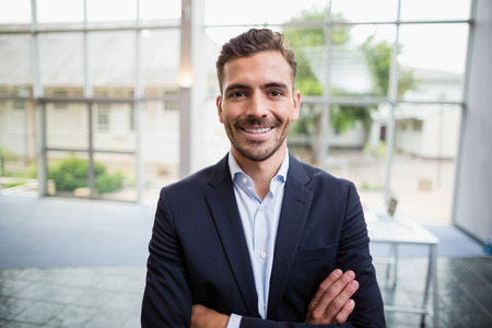 Portrait of a cheerful businessman at conference centre Stock Photo