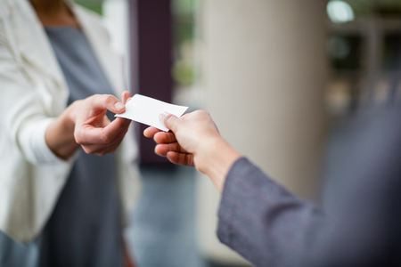 conference centre: Close-up of business executives exchanging business card at conference centre Stock Photo