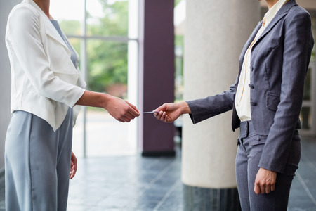 conference centre: Business executives exchanging business card at conference centre