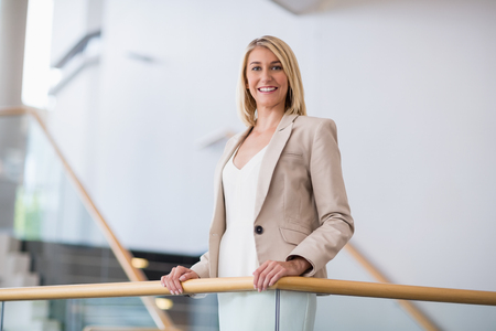 conference centre: Portrait of a beautiful businesswoman standing in conference centre Stock Photo