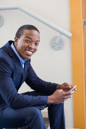 company premises: Portrait of a businessman holding mobile phone Stock Photo