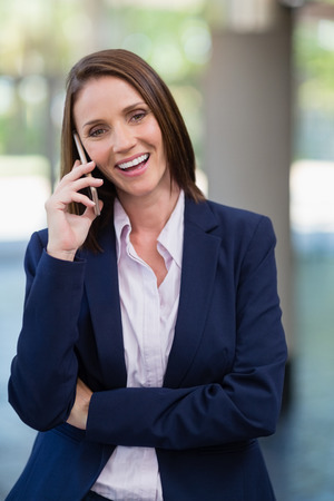 premises: Portrait of a businesswoman talking on mobile phone at conference centre Stock Photo