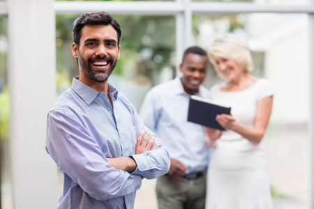 conference centre: Portrait of a cheerful businessman at conference centre Stock Photo