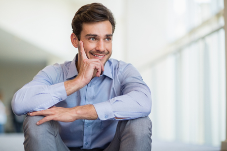 conference centre: Close-up of happy businessman at conference centre
