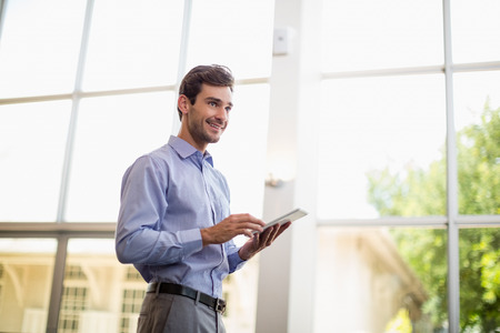 conference centre: Businessman using digital tablet at conference centre Stock Photo