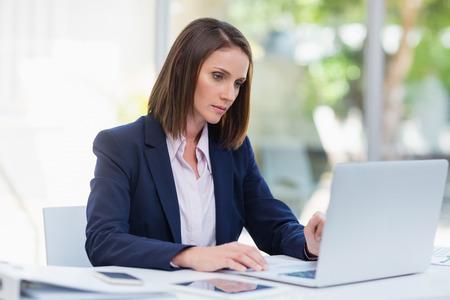 premises: Businesswoman using laptop at conference centre Stock Photo