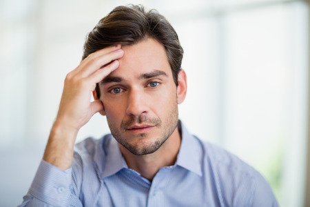 Close-up of worried businessman with hand on head Stock Photo