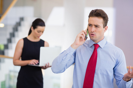 conference centre: Businessman talking on mobile phone at conference centre