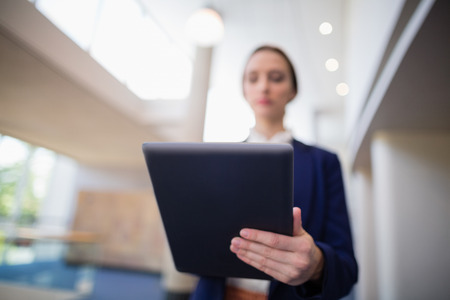 conference centre: Businesswoman using digital tablet at conference centre