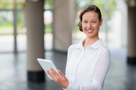 Portrait of a businesswoman holding digital tablet at conference centre Stock Photo