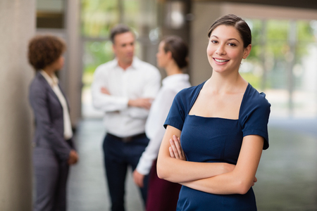 company premises: Portrait of confident and beautiful business executive at conference centre Stock Photo