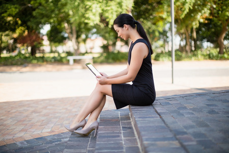 Businesswoman using digital tablet outside the conference centre