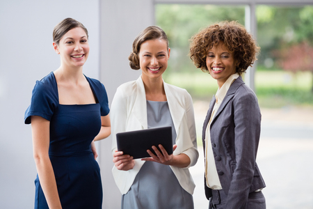 conference centre: Business executives holding digital tablet at conference centre Stock Photo