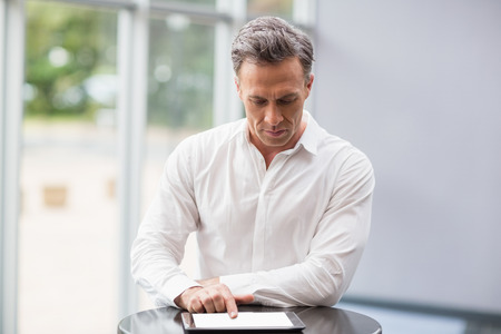 premises: Businessman using digital tablet at conference centre Stock Photo