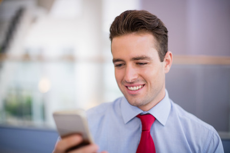 premises: Close-up of businessman using mobile phone at conference centre Stock Photo