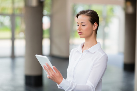 premises: Businesswoman using digital tablet at conference centre