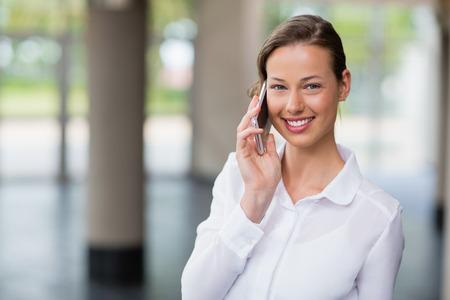 premises: Portrait of a businesswoman talking on mobile phone