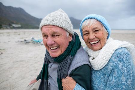 Happy senior couple having fun together at beach Stock Photo