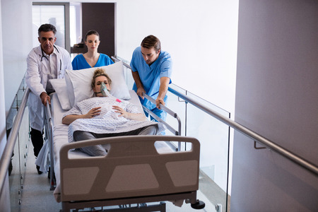 Team of doctors taking pregnant woman to operation theatre in the hospital Stock Photo