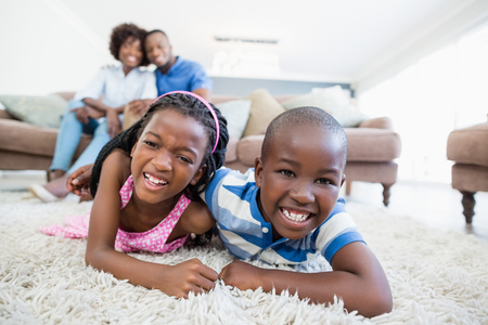 Siblings playing in living room at home