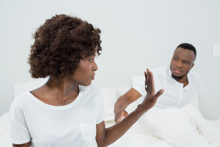 nightwear: Couple arguing with each other in bedroom at home