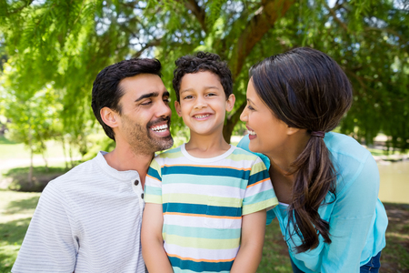 Happy family enjoying together in park Stock Photo