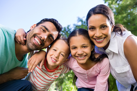 Portrait of smiling family in park on a sunny day